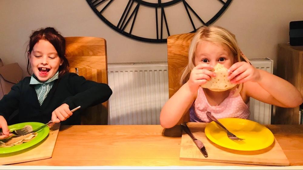 Kids enjoying pancakes